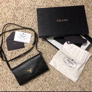Authentic Prada black cross over bag with strap